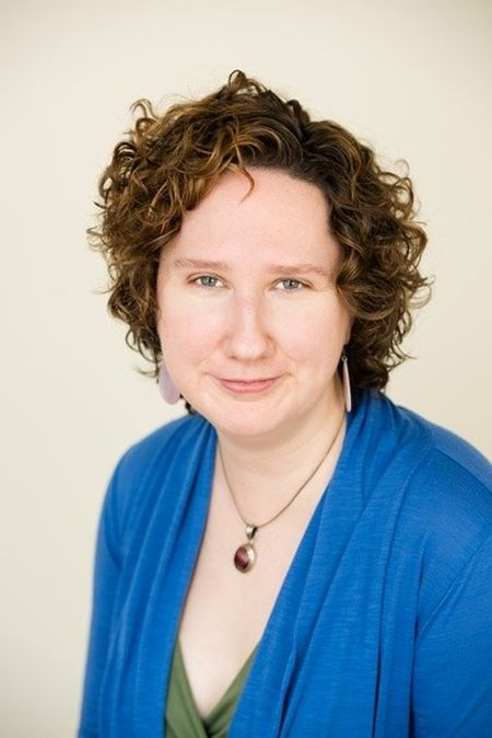 A headshot of Courtney Hill, Owner of Window of Heaven Acupuncture and Yoga